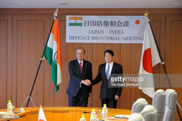 Indian Defense Minister Arun Jaitley shakes hands with Japanese Defense Minister Itsunori Onodera prior to their meeting at the Defense Ministry on...