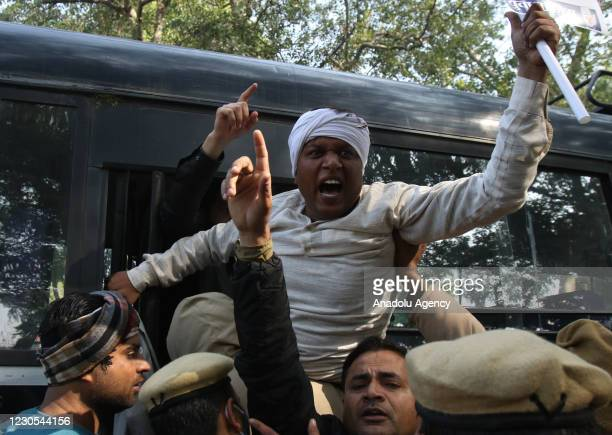 Indian Delhi police detain members of Indians opposition Congress Party during a protest against the central government's recent agricultural reforms...