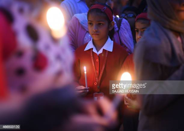 Indian demonstrator hold candles as they take part in a vigil and silent protest against the alleged gangrape of a nun in the eastern state of West...