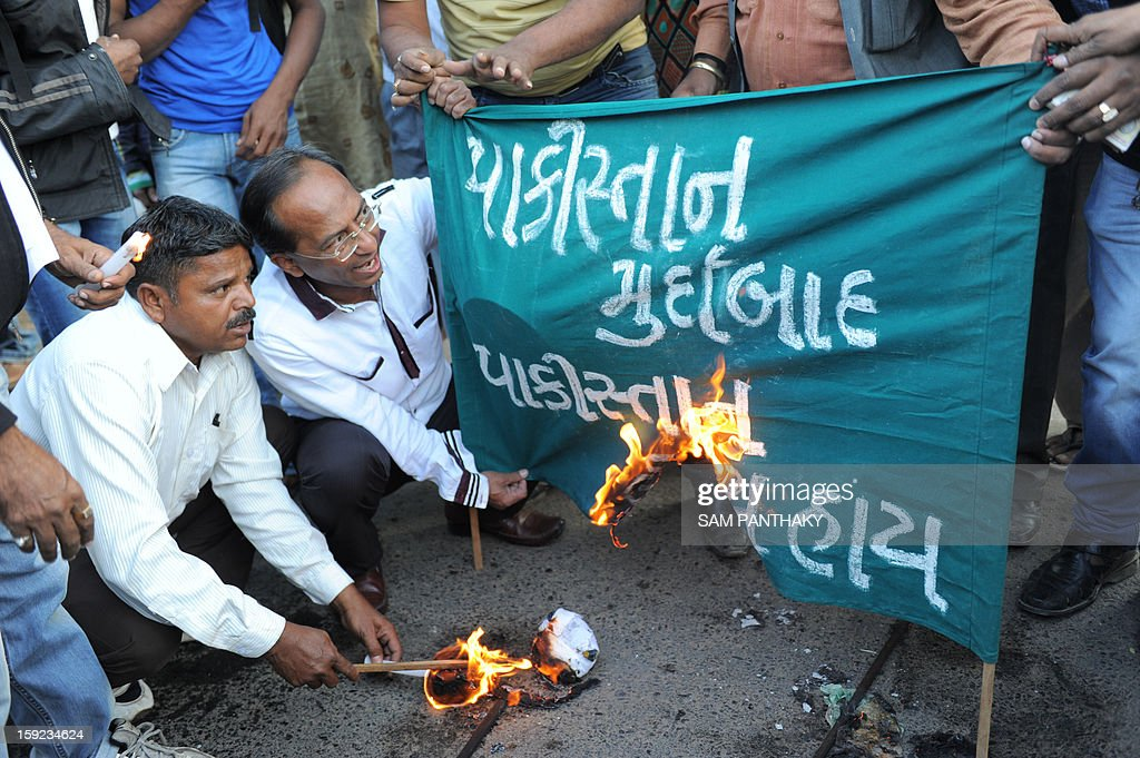 Indian demonstrators burn a banner which reads 'Down with Pakistan, Shame on Pakistan' as they demonstrate against the alleged killing of two Indian soldiers by Pakistan in the disputed Kashmir region, in Ahmedabad on January 10, 2013. Pakistan on January 10 accused Indian troops of opening fire and killing a Pakistani soldier, the third deadly cross-border incident in days that threatens to escalate tensions in Kashmir. AFP PHOTO / Sam PANTHAKY