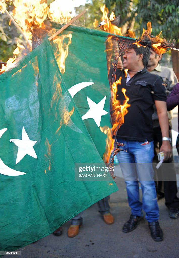 Indian demonstrators burn Pakistani national flags as they demonstrate against the alleged killing of two Indian soldiers by Pakistan in the disputed Kashmir region, in Ahmedabad on January 10, 2013. Pakistan on January 10 accused Indian troops of opening fire and killing a Pakistani soldier, the third deadly cross-border incident in days that threatens to escalate tensions in Kashmir. AFP PHOTO / Sam PANTHAKY