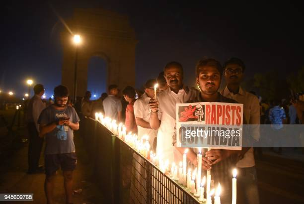 Indian demonstrators gather at the India Gate monument for a late night candlelight vigil in protest over the gang rape and murder of an eightyearold...