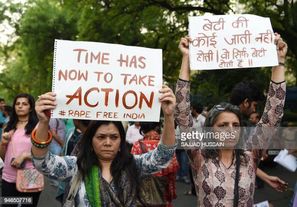 Indian demonstrators hold placards during a silent protest 'Not In My Name' in support of rape victims following high profile cases in Jammu and...