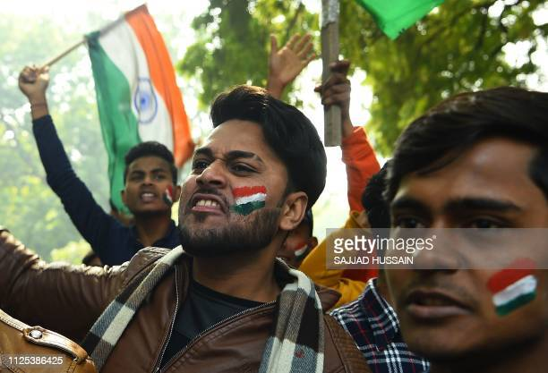 Indian demonstrators shout slogans against Pakistan during a protest in New Delhi on February 17 after an attack on a paramilitary Central Reserve...