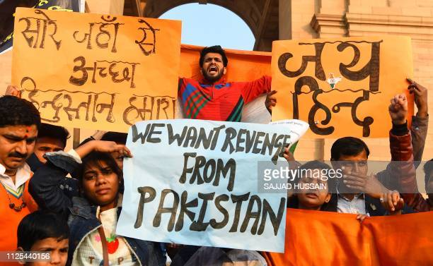 Indian demonstrators shout slogans against Pakistan during a protest at India Gate in New Delhi on February 17 after an attack on a paramilitary...