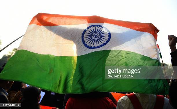 TOPSHOT Indian demonstrators shout slogans against Pakistan during a protest at India Gate in New Delhi on February 17 after an attack on a...