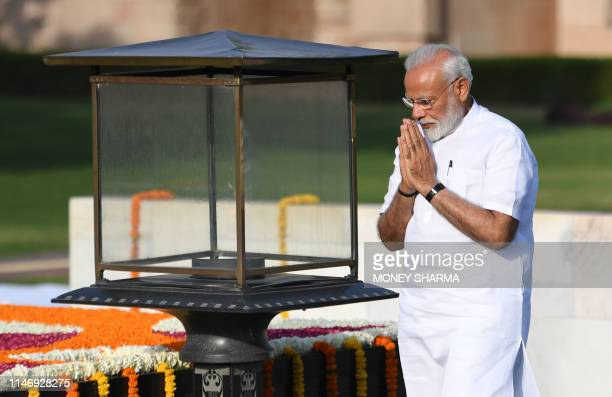Indian designated Prime Minister Narendra Modi pays tribute at Rajghat the memorial for Mahatama Gandhi in New Delhi on May 30 2019 Modi will be...