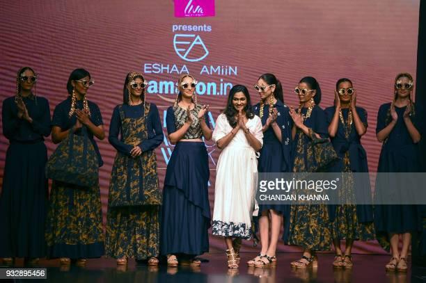 Indian designer Eshaa Amiin greets during the Amazon India Fashion Week Autumn Winter 2018 in New Delhi on March 16 2018 / AFP PHOTO / CHANDAN KHANNA