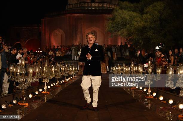 Indian designer Rohit Bal gestures poses during the Grand Final of the Wills Lifestyle Indian Fashion Week Spring/Summer 2015 Collection in New Delhi...