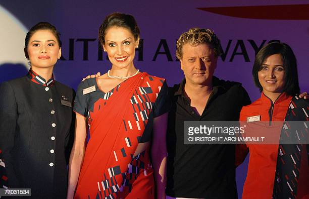 Indian designer Rohit Bal poses with British Airways air hostesses during the unveiling of new cabin crew uniforms in New Delhi 26 September 2007...