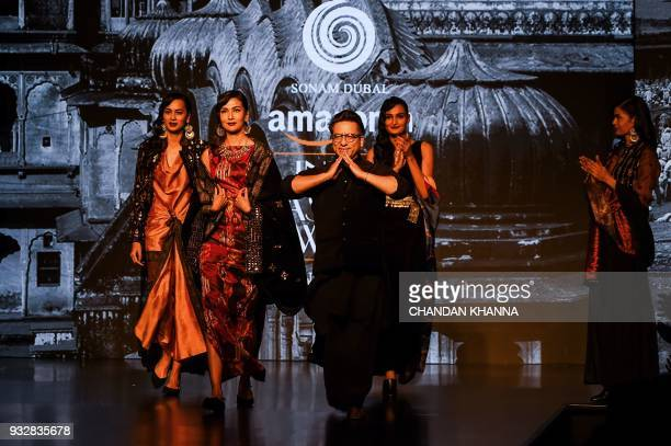 Indian designer Sonam Dubal greets visitors during the Amazon India Fashion Week Autumn Winter 2018 in New Delhi on March 16 2018 / AFP PHOTO /...