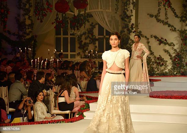 Indian designer Varun Bahl created a floral wonderland for his bridal couture line show on day three at the Fashion Design Council of India's Amazon...