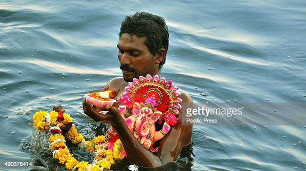 Indian devotee carries an idol of elephantheaded Hindu God Lord Ganesha for immersion in the Yamuna river in New Delhi During the eleventhday of...