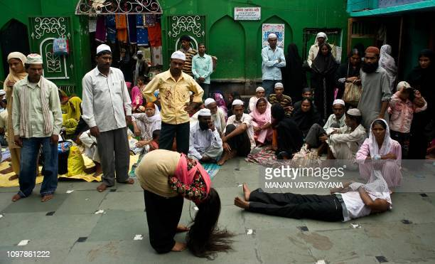 Indian devotees believed to be possessed by evil spirits goes in a state of trance at the Hazrat Shahdana Wali Dargah in Bareilly around 300kms from...