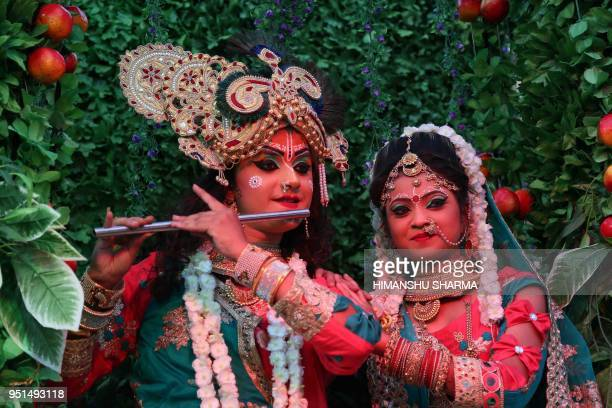 TOPSHOT Indian devotees dressed as the Hindu deities Lord Radha Krishna pose during Shyam Baba festival in Ajmer in the Indian state of Rajasthan on...