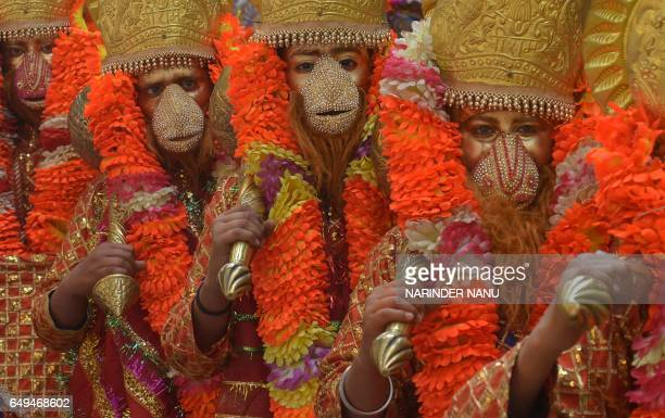 Indian devotees dressed as the Hindu God Hanuman participate in a religious procession ahead of the Holi festival in Amritsar on March 8 2017 Holi...