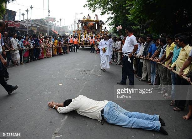 Indian devotees lies on a road during the Ulta Rath Yatra festival in Kolkata India on Thursday 14th July 2016