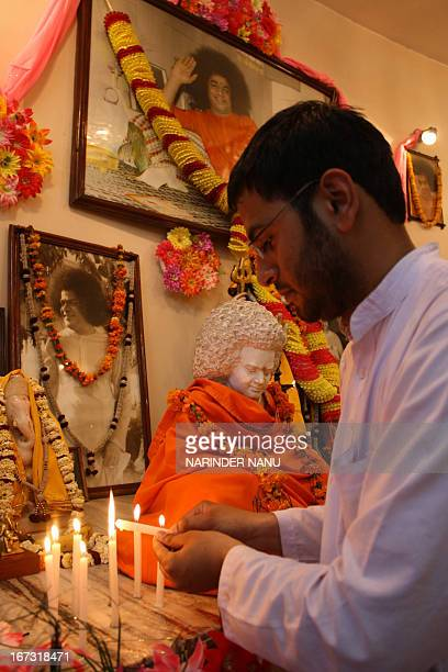 Indian devotees light candles during the second death anniversary of Sri Satya Sai Baba at a temple in Amritsar on April 24 2013 Sathya Sai Baba one...