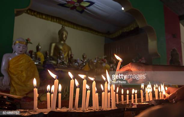 Indian devotees light candles on the occasion of Buddha Purnima at Namphakey Buddhist Monastery in Naharkatia in the northeastern state of Assam on...