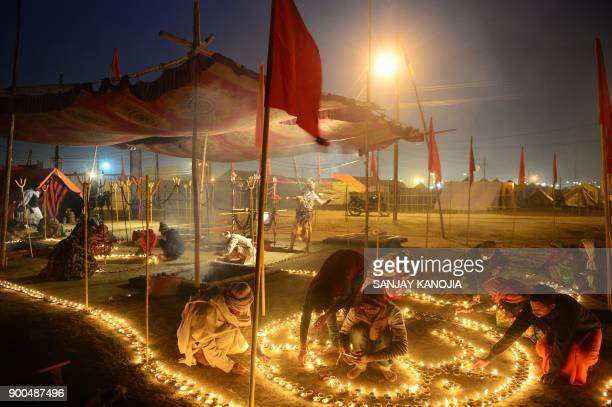 TOPSHOT Indian devotees light oil lamps on the occasion of 'Paush Purnima' at Sangam during the annual traditional fair Magh Mela at Sangam the...
