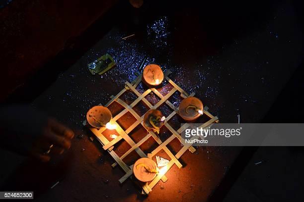 Indian devotees lit earthen lamps att Ram Ghaton the banks of Mandakini Riverduring a Religious processsion on ocassion of Diwali festivalat...