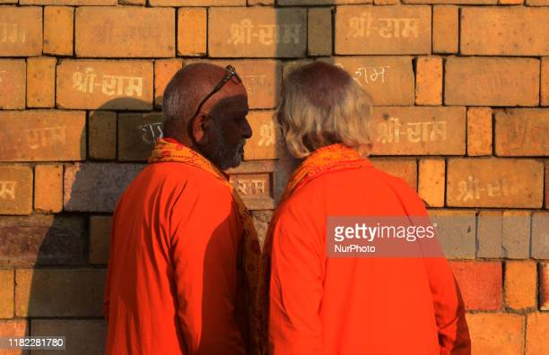 Indian devotees look on the bricks reading quotShree Ramquot which are expected to use in constructing the Ram temple in Ayodhya India November 14...