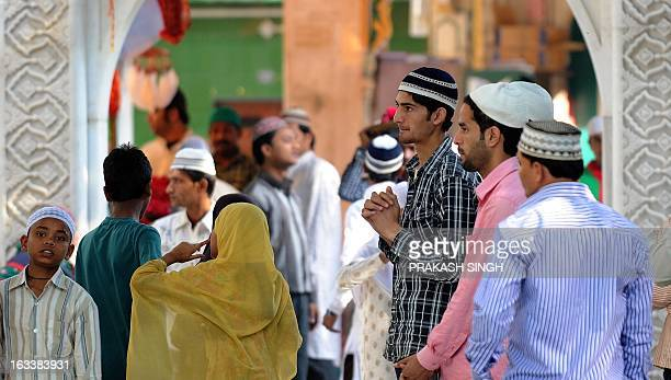 Indian devotees offer prayers at the Ajmer Sharif shrine in Ajmer on March 9 2013 Pakistan's Prime Minister Raja Pervez Ashraf is arriving in India...