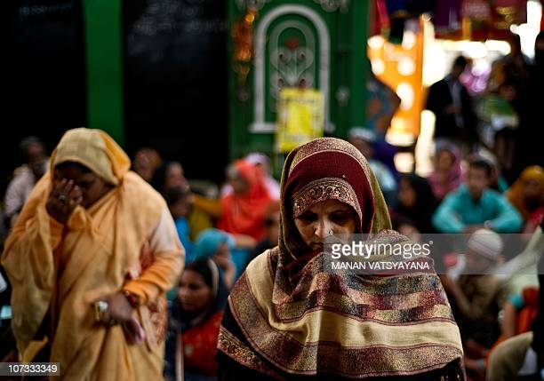 Indian devotees offer prayers at the Hazrat Shahdana Wali Dargah in Bareilly around 300kms from New Delhi on December 22010 More than a thousand...
