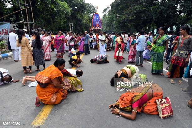 Indian Devotees offer their respect to Lord Jagannath during the last day of the week long Rathyatra celebration of Lode Jagannath's Rath Yatra on...