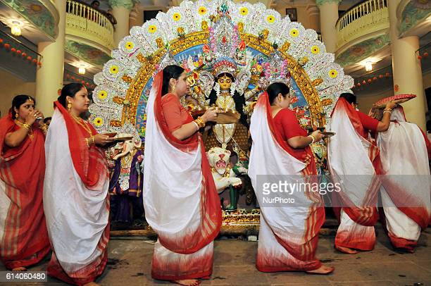Indian Devotees perform ritual to an idol of Hindu goddess Durga on the last day of Durga Puja festival in the eastern Indian city of Kolkata October...