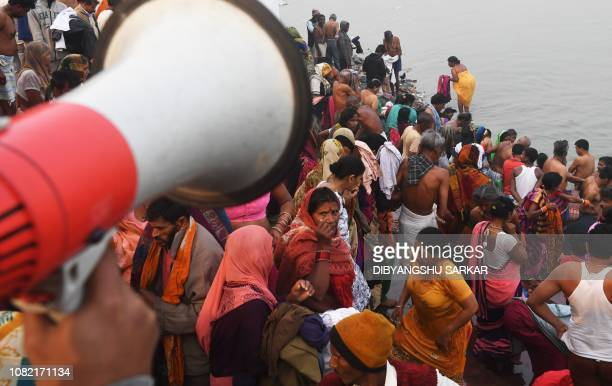 Indian devotees prepare to take a dip in the River Ganges to mark the Hindu festival of Makar Sankranti in Kolkata on January 14 2019