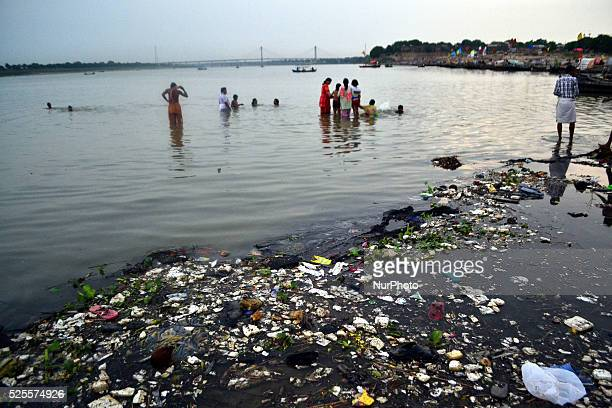 Indian devotees take a holy dip on the polluted river banks of River Gangesin Allahabad on July 62015Indian Prime Minister Narendra Modi vowed to...