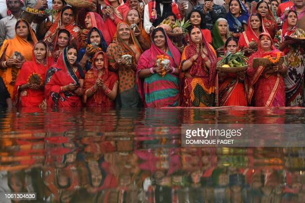 TOPSHOT Indian devotees take part in a ritual worshipping the sun god during the Chhath Festival on the banks of the holy river Ganges in Varanasi on...