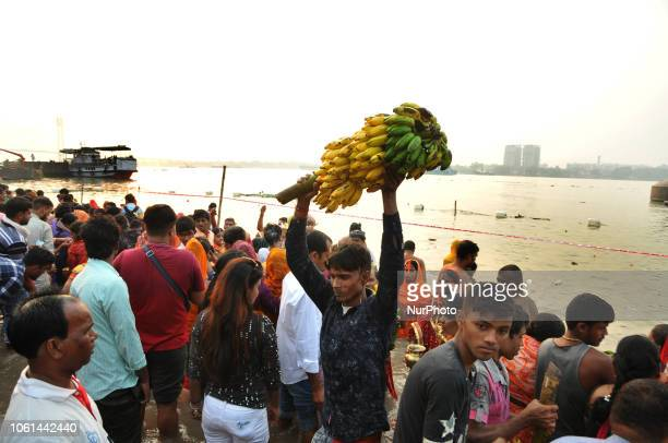 Indian devotees take part in a ritual worshipping the sun god during the Chhath Festival on the banks of the holy river Ganges in KolkataWest Bengal...