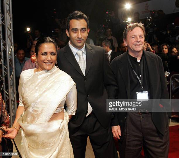 Indian director Deepa Mehta arrives with Bollywood actor Rahul Khanna the son of actor Vinod Khanna and unidentified guest at the opening ceremony of...