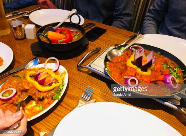 indian dishes on restaurant table - tikka masala stock pictures, royalty-free photos & images