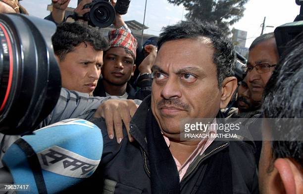 Indian doctor Amit Kumar believed to have masterminded an illegal kidney transplant operation in India is escorted by police officials in Kathmandu...