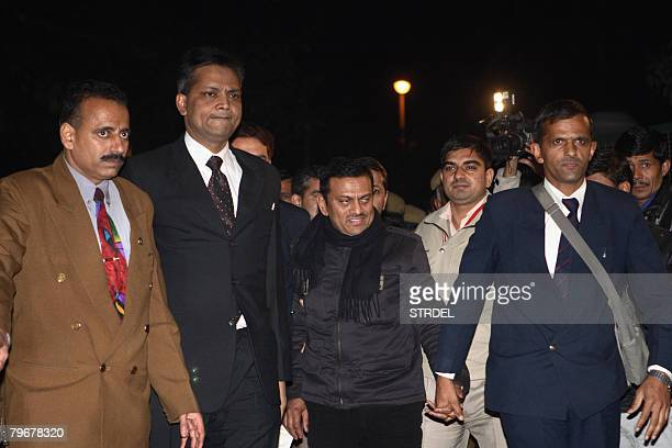 Indian doctor Amit Kumar is escorted under custody by detectives of the Central Bureau of Investigation in New Delhi on February 9 2008 Kumar accused...