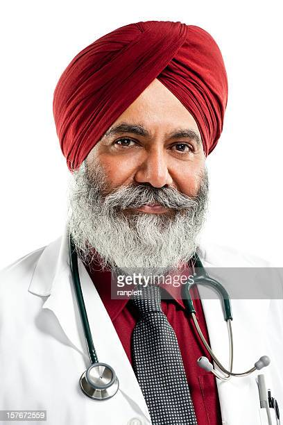 indian doctor wearing turban - isolated - sikh stock pictures, royalty-free photos & images