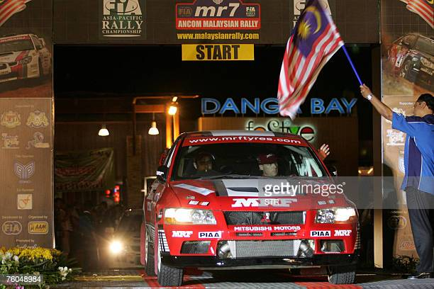 Indian driver Gaurav Gill and codriver Australian Karl Francis of MRF Tyres Rally Team drive their Mitsubishi Lancer Evo 7 past the gates during the...