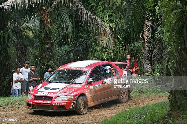 Indian driver Gaurav Gill and codriver Australian Karl Francis of MRF Tyres Rally Team drive through with a punctured tyre on their Mitsubishi Lancer...