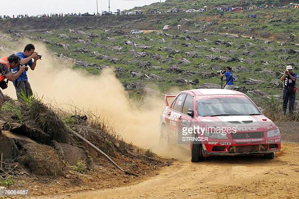 Indian driver Gaurav Gill and codriver Australian Karl Francis of MRF Tyres Rally Team take a corner with a punctured tyre on their Mitsubishi Lancer...