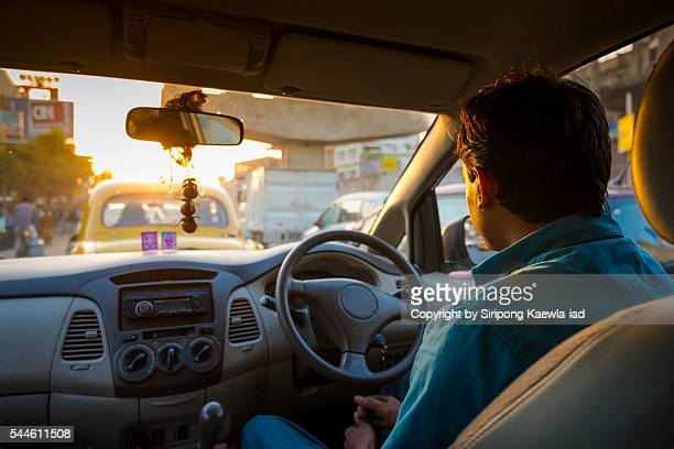 indian driver is driving on the road during rush hour in kolkata - taxi driver stock photos and pictures
