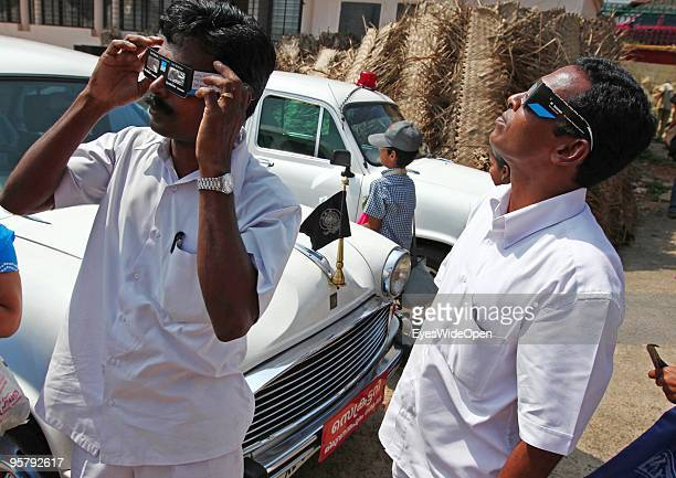 Indian driver with their ambassador cars observe the rare Annular Solar Eclipse on January 15 2010 at the central stadium of Thiruvananthapuram in...