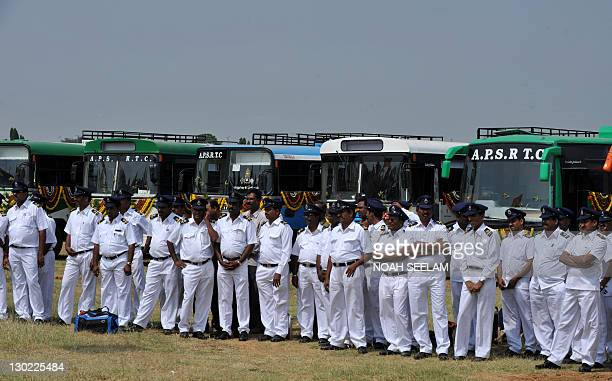Indian drivers of The Andhra Pradesh State Road Transport Corporation stand in front of the newly equipped compressed natural gas buses during a...