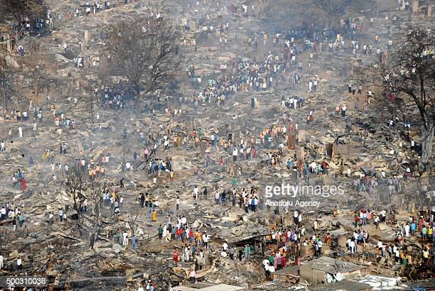 Indian dwellers collect their belongings from the charred remains following a fire at a slum in the east of Kandivali an area in the north of Mumbai...