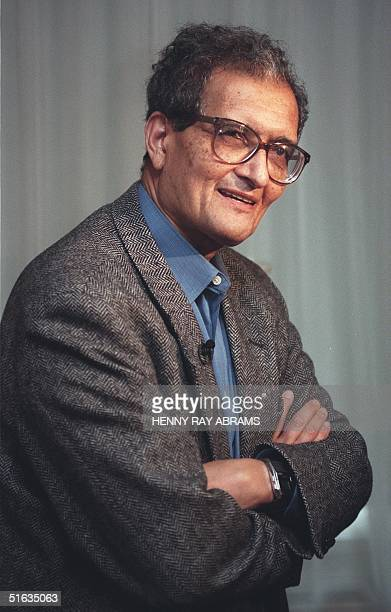 Indian economist Amartya Sen a professor at Trinity College in Cambridge England stands at a press conference after hearing the news he won the Nobel...
