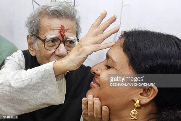 Indian economist Amlan Datta blesses a sex worker during 'Bhai Phonta' festival in Kolkata on October 30 2008 Bhai Phonta is a festival where sisters...