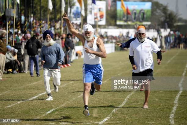 Indian elderly competitors take part in a running race for the over 70s during the second day of the Kila Raipur Games popularly known as the rural...