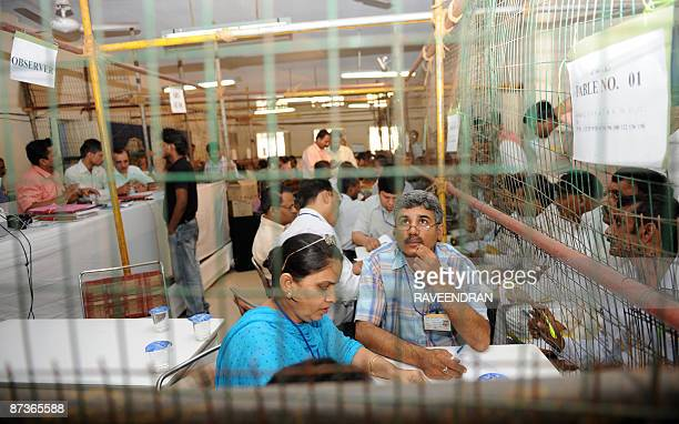 Indian election officers at a counting station in New Delhi on May 16 2009 Congress Partyled UPA parties are currently leading the country's...